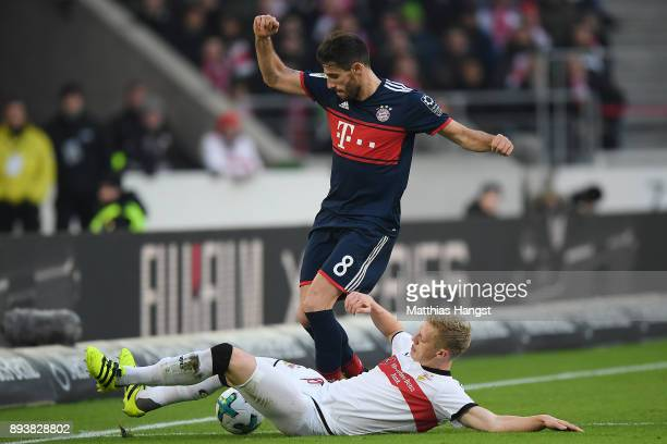 Javi Martinez of Bayern Muenchen fights for the ball with Timo Baumgartl of Stuttgart during the Bundesliga match between VfB Stuttgart and FC Bayern...