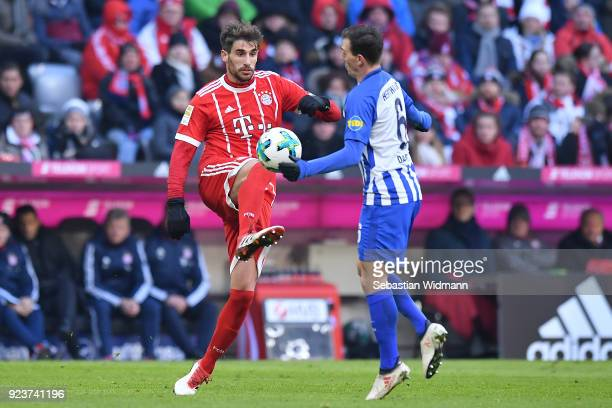 Javi Martinez of Bayern Muenchen fights for the ball with Vladimír Darida of Berlin during the Bundesliga match between FC Bayern Muenchen and Hertha...