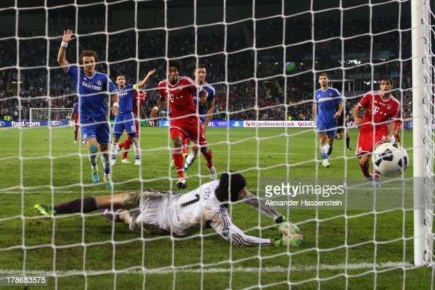 Javi Martinez of Bayern Muenchen scores the second team goal against Petr Cech, keeper of Chelsea during the UEFA Super Cup between FC Bayern...