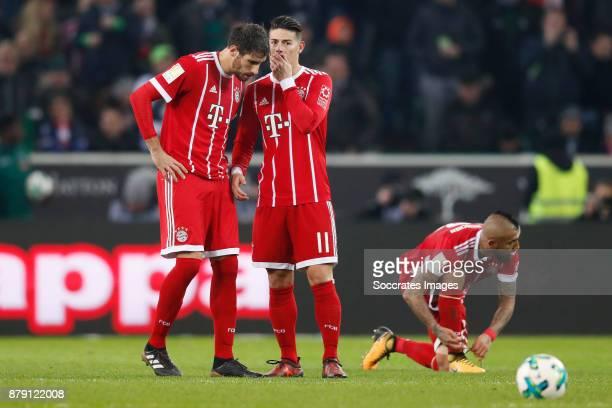 Javi Martinez of Bayern Munchen James Rodriguez of FC Bayern Munchen Arturo Vidal of Bayern Munchen during the German Bundesliga match between...