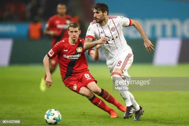 Javi Martinez of Bayern Munich and Lars Bender of Bayer Leverkusen battle for the ball during the Bundesliga match between Bayer 04 Leverkusen and FC...
