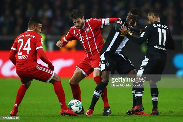Javi Martinez of Bayern Munich battles for the ball with Denis Zakaria of Borussia Monchengladbach during the Bundesliga match between Borussia...