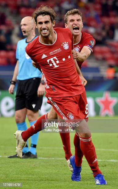 Javi Martinez of Bayern Munich celebrates with teammate Thomas Mueller after scoring his team's second goal during the UEFA Super Cup match between...