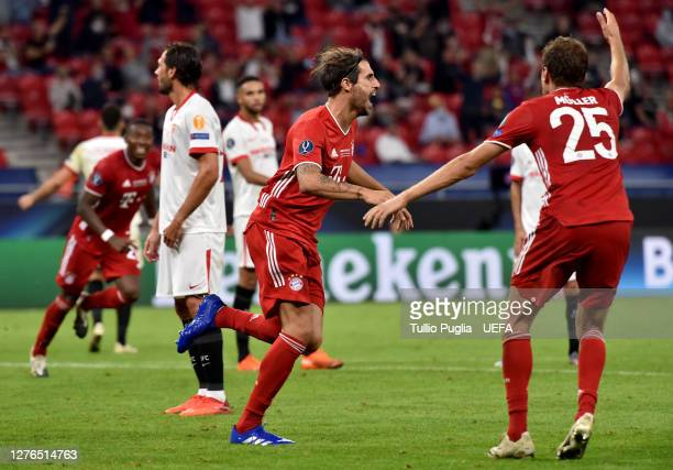 Javi Martinez of Bayern Munich celebrates with teammates after scoring his team's second goal during the UEFA Super Cup match between FC Bayern...