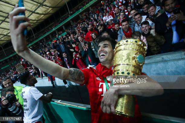 Javi Martinez of Bayern Munich poses with the DFB Pokal following his team's victory in the DFB Cup final between RB Leipzig and Bayern Muenchen at...