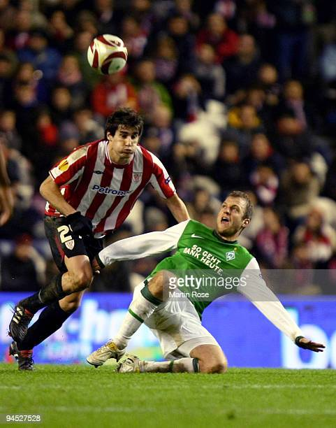 Javi Martinez of Bilbao and Daniel Jensen of Bremen compete for the ball during the UEFA Europa League Group L match between Atletico Bilbao and...