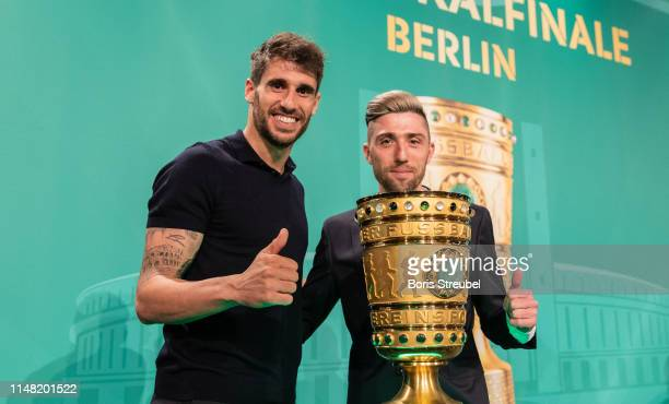 Javi Martinez of FC Bayern Muenchen and Kevin Kampl of RB Leipzig pose with the cup during the DFB Cup Handover 2019 at Altes Stadthaus on May 10...