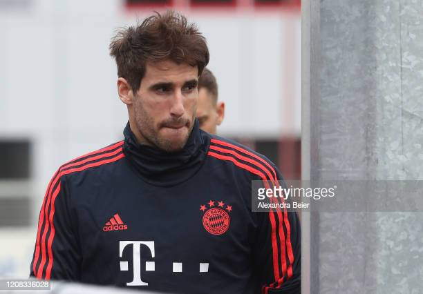 Javi Martinez of FC Bayern Muenchen arrives for a training session ahead of their Champions League round of 16 match against Chelsea FC at Saebener...