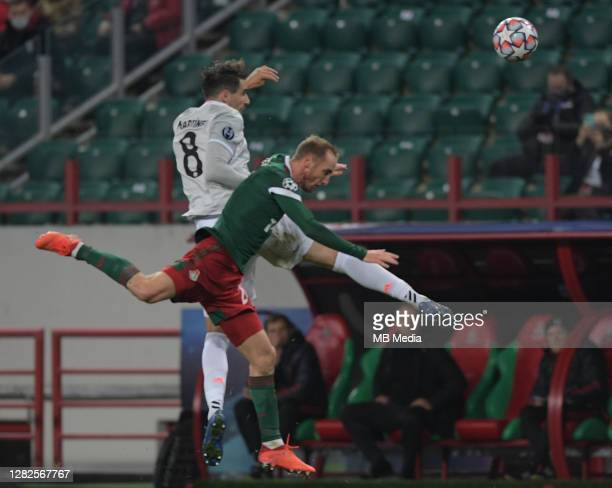 Javi Martinez of FC Bayern Muenchen competes for the ball with Vladislav Ignatyev of Lokomotiv Moskva during the UEFA Champions League Group A stage...