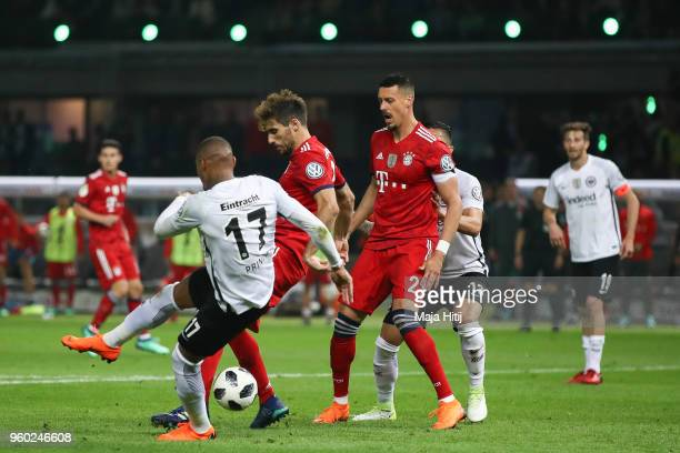 Javi Martinez of FC Bayern Muenchen is challenged by KevinPrince Boateng of Eintracht Frankfurt during the DFB Cup final between Bayern Muenchen and...