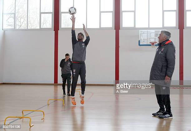 Javi Martinez of FC Bayern Muenchen plays basketball next to team coach Carlo Ancelotti before a training session at the Saebener Strasse training...