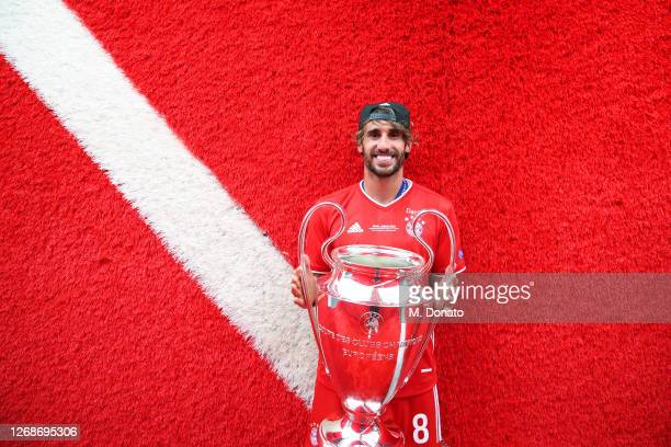 Javi Martinez of FC Bayern Muenchen poses with the trophy outside the dressing room following his team's victory in the UEFA Champions League Final...