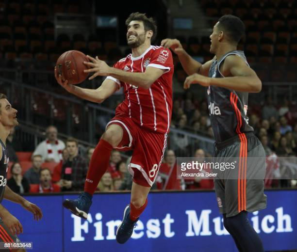 Javi Martinez of FC Bayern Muenchen tries to score against Karim Jallow of FC Bayern Basketball during a basketball match at the 'Paulaner Fan...