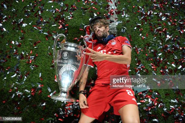 Javi Martinez of FC Bayern Munich celebrates with the UEFA Champions League Trophy following his team's victory in the UEFA Champions League Final...