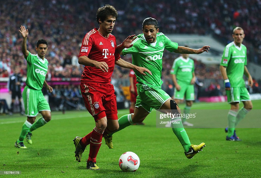 Javi Martinez (L) of Muenchen and Ricardo Rodriguez of Wolfsburg compete for the ball during the Bundesliga match between FC Bayern Muenchen and VfL Wolfsburg at Allianz Arena on September 25, 2012 in Munich, Germany.