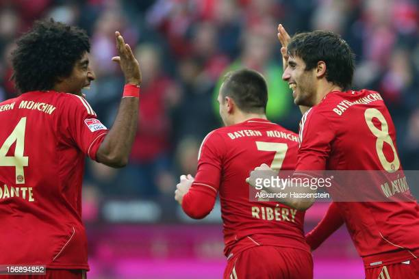 Javi Martinez of Muenchen celebrates scoring the opening goal with his team mates Datne and Franck Ribery during the Bundesliga match between FC...