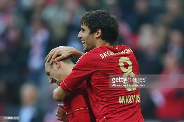Javi Martinez of Muenchen celebrates scoring the opening goal with his team mate Franck Ribery during the Bundesliga match between FC Bayern Muenchen...