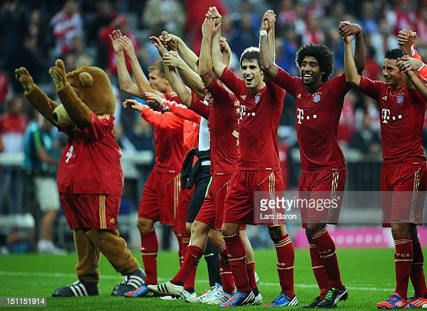 Javi Martinez of Muenchen celebrates with Dante Claudio Pizarro and other team mates after winning the Bundesliga match between FC Bayern Muenchen...