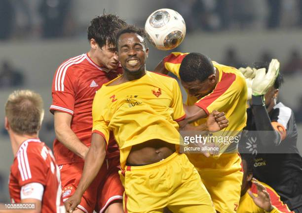 Javi Martinez of Munich and Ghandi Cassino Haitham Mustafa and Goalkeeper Akram El Hadi Salim of AlMerrikh vie for the ball during the international...