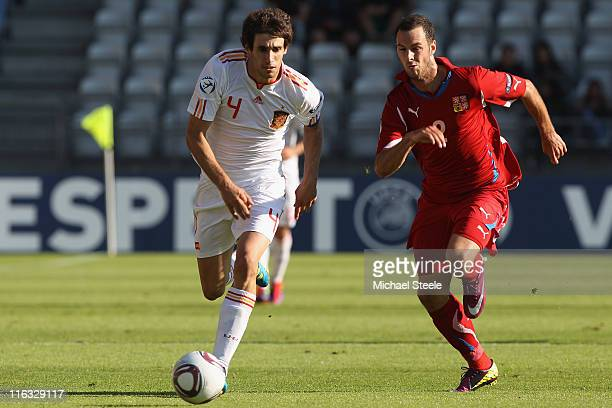 Javi Martinez of Spain is tracked by Jan Lecjaks during the UEFA European Under21 Championship Group B match between Czech Republic and Spain at the...