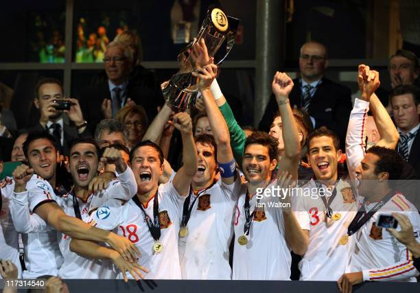 Javi Martinez the captain of Spain lifts the winners trophy after his side's 20 victory after their UEFA European U21 Championship Final match...