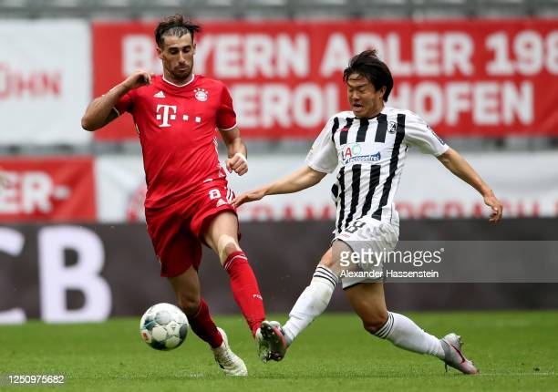 Javi Martínez of Bayern Muenchen challenges Chang-Hoon Kwon of Freiburg during the Bundesliga match between FC Bayern Muenchen and Sport-Club...