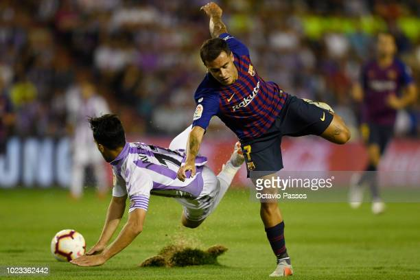 Javi Moyano of Valladolid competes for the ball with Philippe Coutinho of Barcelona during the La Liga match between Real Valladolid CF and FC...
