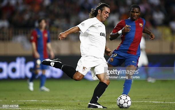 Javi Navarro and Samuel Eto'o during the 2006 UEFA Super Cup match between FC Barcelona and Sevilla FC
