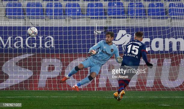 Javi Ontiveros of Huesca scores their team's first goal from a penalty during the La Liga Santander match between SD Huesca and Levante UD at Estadio...