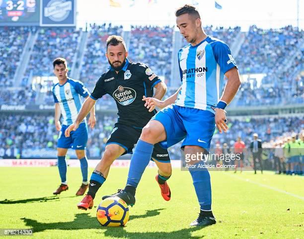 Javi Ontiveros of Malaga CF being followed by Emre Colak of RC Deportivo during the La Liga match between Malaga and Deportivo La Coruna at Estadio...