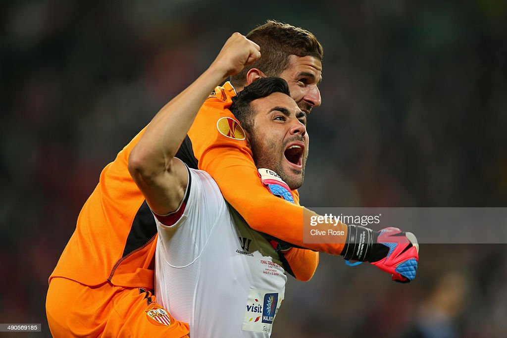 Javi Varas of Sevilla celebrates victory with Vicente Iborra of Sevilla during the UEFA Europa League Final match between Sevilla FC and SL Benfica at Juventus Stadium on May 14, 2014 in Turin, Italy.