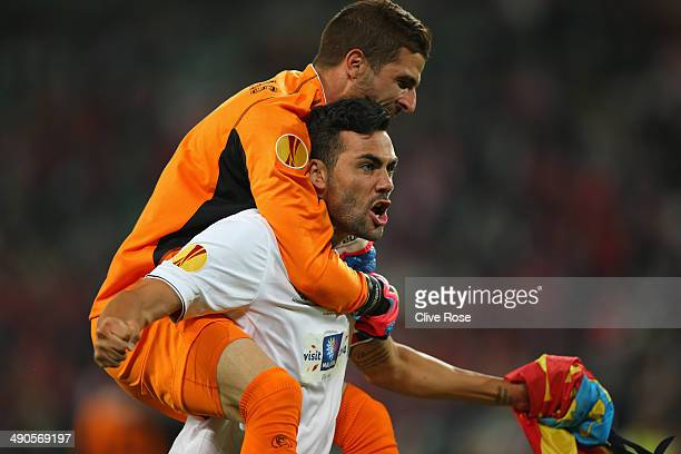 Javi Varas of Sevilla celebrates victory with Vicente Iborra of Sevilla during the UEFA Europa League Final match between Sevilla FC and SL Benfica...