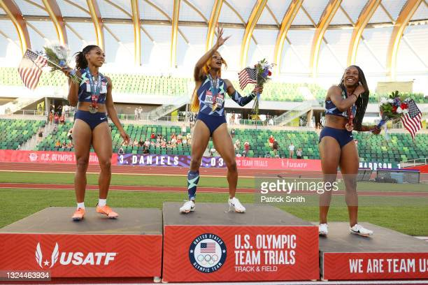 Javianne Oliver, Sha'Carri Richardson and Teahna Daniels stand on the podium after the Women's 100 Meter final on day 2 of the 2020 U.S. Olympic...