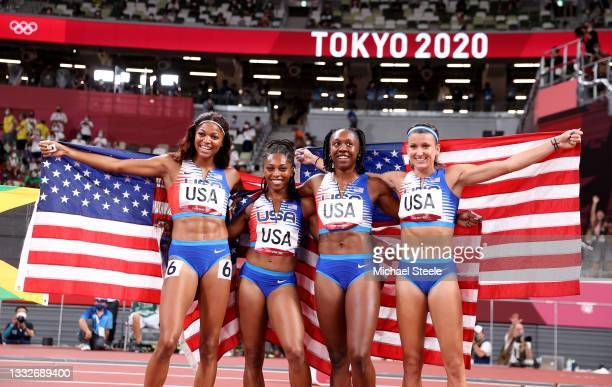Javianne Oliver, Teahna Daniels, Jenna Prandini and Gabrielle Thomas of Team United States celebrate winning the silver medal in the Women's 4 x 100m...