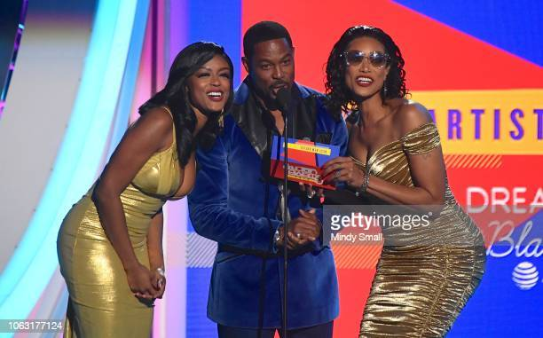 Javicia Leslie Darrin Dewitt Henson and Tami Roman present the Best New Artist award onstage during the 2018 Soul Train Awards at the Orleans Arena...