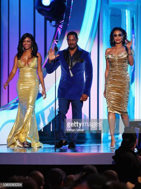 Javicia Leslie Darrin Henson and Tami Roman present the Best New Artist award onstage during the 2018 Soul Train Awards presented by BET at the...