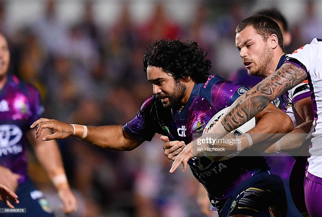 Javid Bowen of the Cowboys is tackled by Cheyse Blair of the Storm during the round 21 NRL match between the North Queensland Cowboys and the Melbourne Storm at 1300SMILES Stadium on July 30, 2016 in Townsville, Australia.