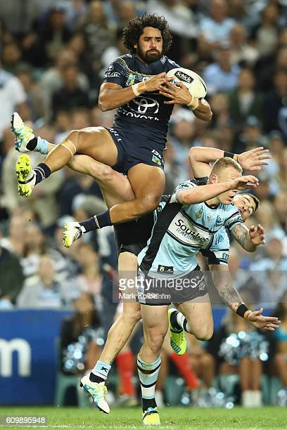 Javid Bowen of the Cowboys wins the ball over Luke Lewis and Jack Bird of the Sharks during the NRL Preliminary Final match between the Cronulla...