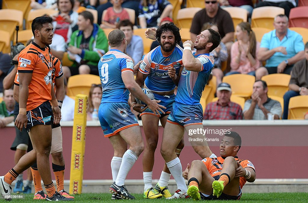 Javid Bowen of the Pride celebrates with team mates after scoring a try during the Intrust Super Cup Grand Final match between Northern Pride and Easts Tigers at Suncorp Stadium on September 28, 2014 in Brisbane, Australia.