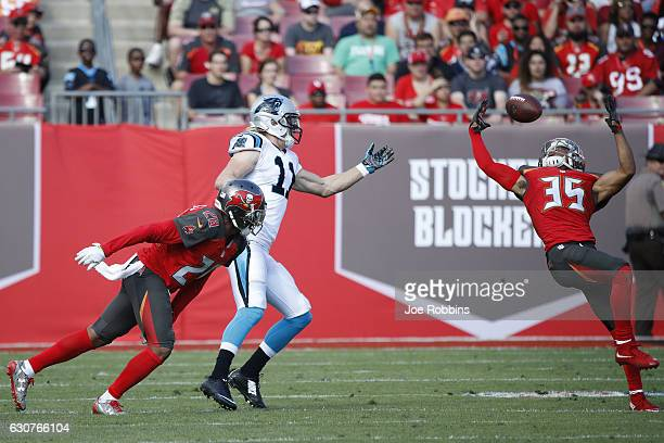Javien Elliott and Vernon Hargreaves III of the Tampa Bay Buccaneers defend a pass against Brenton Bersin of the Carolina Panthers in the second...
