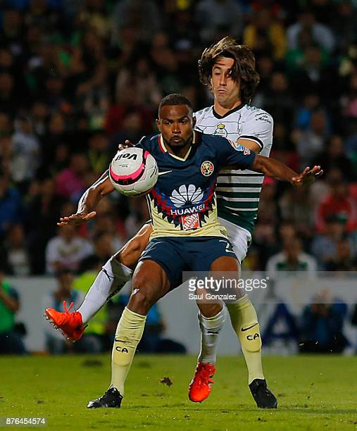 Javier Abella of Santos and William da Silva of America fight for the ball during the 17th round match between Santos Laguna and America as part of...