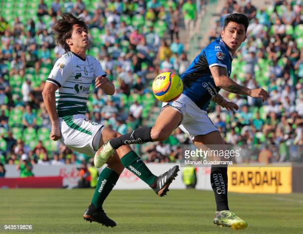 Javier Abella of Santos fights for the ball with Edson Puch of Queretaro during the 14th round match between Santos Laguna and Querataro as part of...