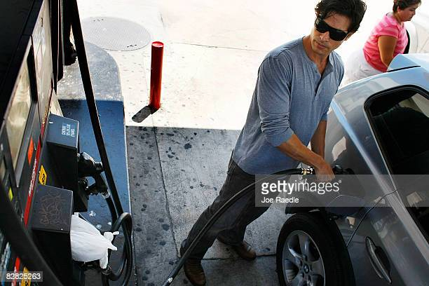 Javier Agusto pumps gas into his car September 15 2008 in Miami Florida Gasoline prices rose nearly 5 cents a gallon Monday bringing the total...