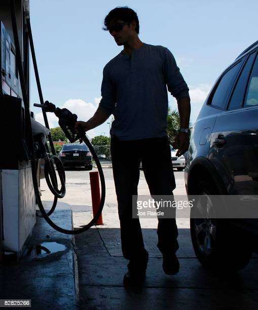 Javier Agusto replaces the hose after pumping gas into his car September 15 2008 in Miami Florida Gasoline prices rose nearly 5 cents a gallon Monday...