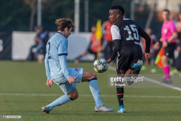 Javier Ajenjo of Atletico Madrid and Franco Tongya of Juventus U19 battle for the ball during the UEFA Youth League match between Juventus U19 and...