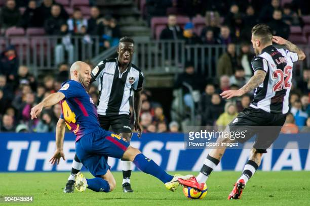 Javier Alejandro Mascherano of FC Barcelona fights for the ball with Antonio Manuel Luna Rodriguez of Levante UD during the La Liga 201718 match...