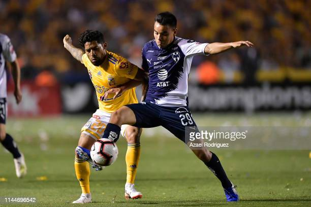 Javier Aquino #20 of Tigres fights for the ball with Carlos Rodríguez #29 of Monterrey during the final first leg match between Tigres UANL and...