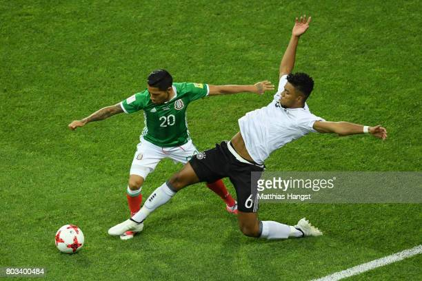 Javier Aquino of Mexico and Benjamin Henrichs of Germany compete for the ball during the FIFA Confederations Cup Russia 2017 SemiFinal between...