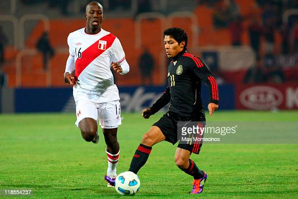 Javier Aquino of Mexico battles for the ball against Luis Advíncula of Peru during a match as part of group C of 2011 Copa America at Malvinas...