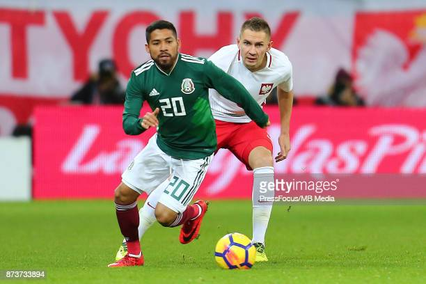 Javier Aquino of Mexico in action with Artur Jedrzejczyk of Poland during the international friendly match between Poland and Mexico on November 13...